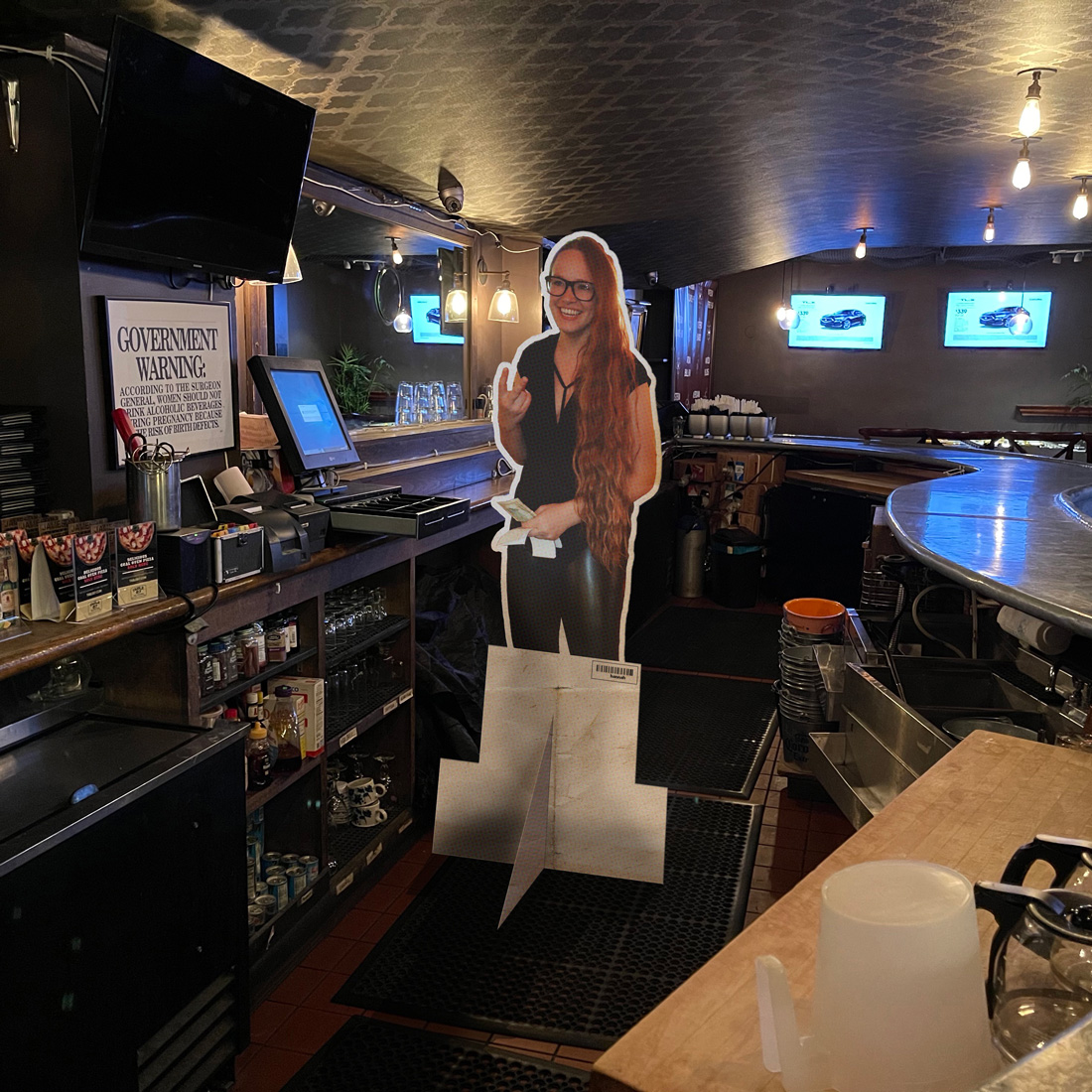 There is a cardboard of Hannah behind the bar